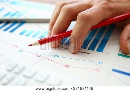Hand With Red Pencil Lies On Comparative Chart. Build Individual Charts Or View Lead Summary Data. D