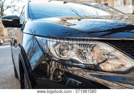 New Clean Black Car Front Headlight With Street Reflection