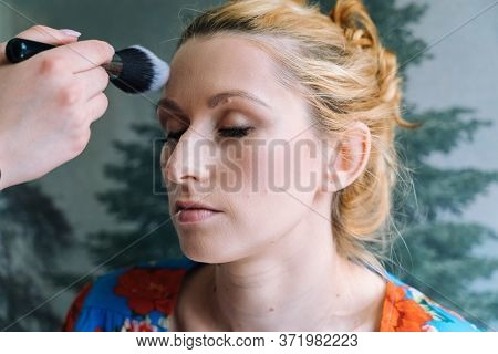 Process Of Making Makeup. Make-up Artist Applied With Brush On Model Face. Portrait Of Young Ginger