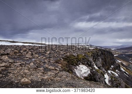 The Amazing Cliff Juts Out Into The Valley In Iceland