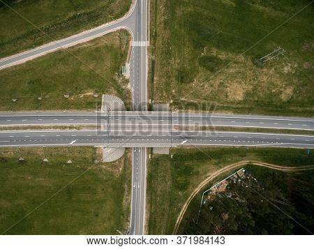 Asphalt Highway And Bridge Road. Top View. Summer Landscape. Drone Photo.