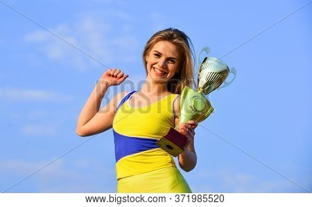 Happy Girl Hold Trophy. Sport Success. Gold Prize. Cute Athlete Being Awarded With Cup. First Place