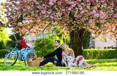 Happy Together. Flowers Symbol Of Romance And Affection. Enjoying Their Perfect Date. Couple Relaxin