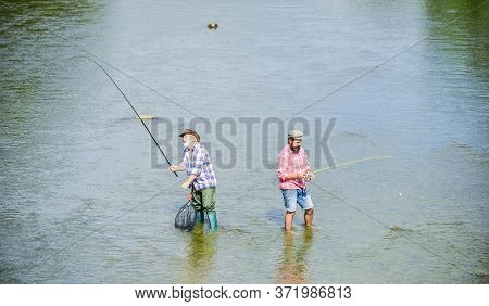 Very Long. Father And Son Fishing. Adventures. Big Game Fishing. Male Friendship. Two Happy Fisherma