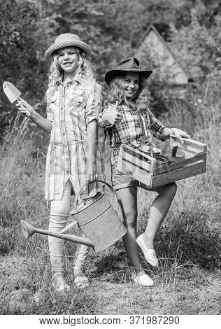 Sisters Helping At Backyard. Girls With Gardening Tools. Child Friendly Garden Tools Ensure Safety O