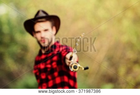 Proper Fishhook. Hook And Bait. Fishing Hobby. Guy In Cowboy Hat Fishing Equipment Nature Background