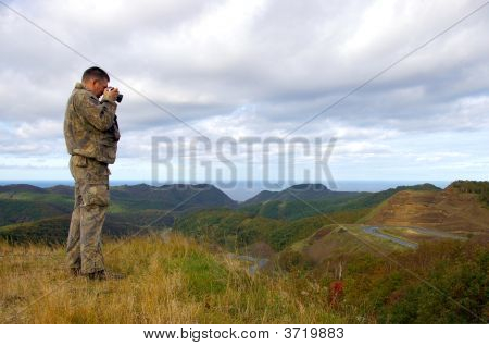 Photorgaf On Peak Of The Mountain.