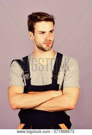 Handsome Repairman. Worker Violet Background. Man Repairman Builder In Work Clothes. Troubleshoot An