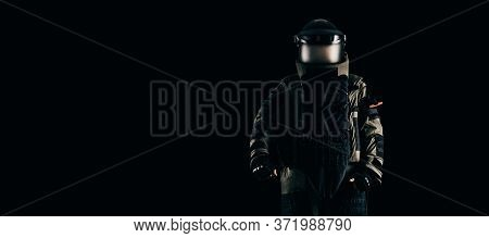 Minesweeper In An Armored Suit. The Concept Of Anti-terrorism. Black Background. Mixed Media