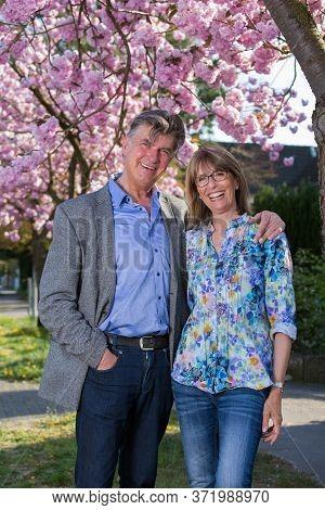 Happy Friendly Attractive Senior Couple Outdoors.