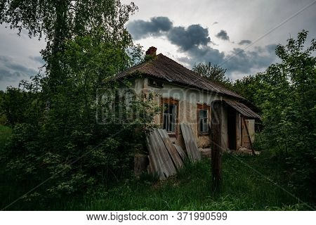 Old Overgrown Abandoned House In Abandoned Russian Village