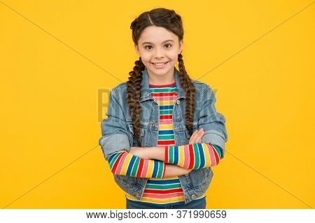 Confident In Her Style. Confident Child Keep Arms Crossed Yellow Background. Confident Look Of Fashi