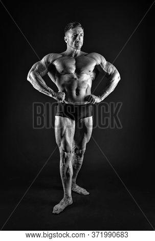 Professional Bodybuilder. Bodybuilder Black Background. Fit Bodybuilder Show Muscular Body. Strong B