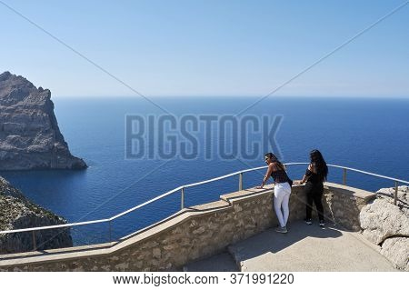 Latin Family, Woman And Children, Enjoying The Views Of The Mediterranean, On A Sunny Spring Day, On