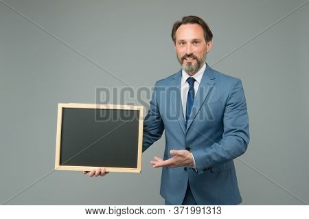 Product Introduction. Businessman Presenting Product At Blackboard. Product Promotion. Product Adver