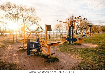 Close Up Outdoors Gym Equipment At The Park Sports Ground. Different Machines For Training, Activity