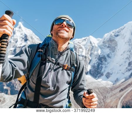 Portrait Of Smiling Hiker Man On Taboche 6495m And Cholatse 6440m Peaks Background With Trekking Pol