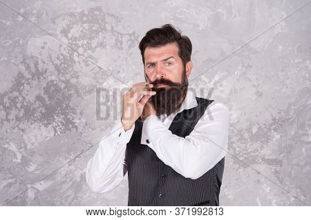 Shaving With Straight Razor. Brutal Hairstylist In Barbershop. Bearded Elegant Mature Man Works At B