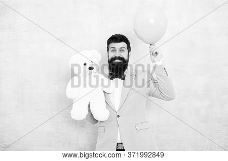 Stereotypical Gifts. Valentines Day. Romantic Man With Teddy Bear And Air Balloon Waiting Girlfriend