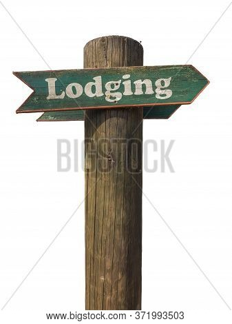 Isolated Wooden Sign Pointing To Lodging With A White Background