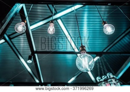 Group Of Teal And Blue Hanging Lamps Of Different Shapes And Type Of The Spiral In A Dark Interior W