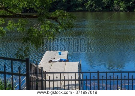 Matawan, New Jersey - June 13: A Boy Takes A Break From Fishing To Find Out What Is Really Going On
