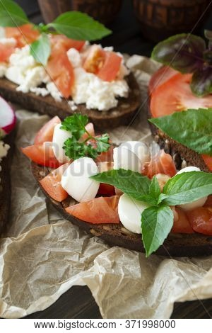 Variety Of Bruschetta Sandwiches. Mix Bruschetta With Mozarella, Tomato, Basil