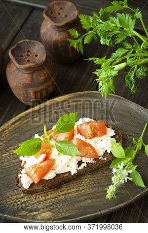 Bruschetta With Ricotta Cheese, Fresh Basil And Tomato