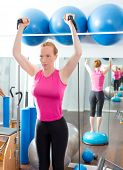 Bosu ball for fitness redhead woman in aerobics gym poster