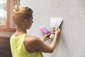 Designer Choosing Paint Color For House Exterior Stucco Facade