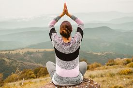 Woman Doing Yoga In Nature. Yoga In Nature. Yoga Lifestyle. Healthy Lifestyle. Woman Doing Yoga On M