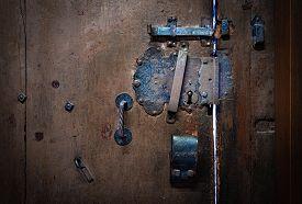 Metal Door Handle And Lock On Old Shabby Wooden Brown Door On House In Germany, Europe.