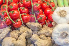 Delicious Fresh Market Vegetables Tomatoes Ginger And Garlic. Offer Mix Box Of Ripe Organic Vegetabl