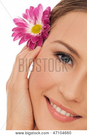 closeup image of beautiful young woman with flower in hair