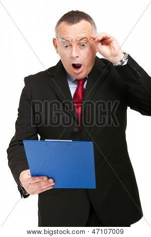 Shocked businessman isolated on white while reading an expensive bill poster