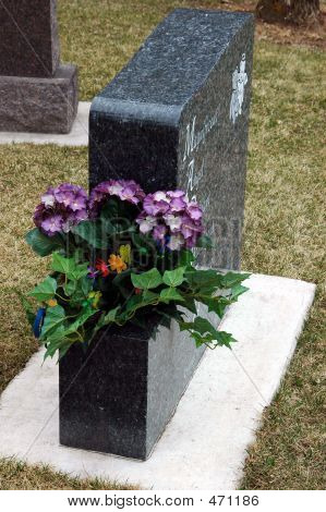Granite Headstone And Flowers