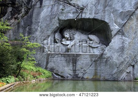 Lion Monument (L???wendenkmal) a historic landmark (1821) in Lucerne, Switzerland was carved in the rock to honor the Swiss Guards of Lois XVI of France who defended the Palais des Tuileries in Paris and died in the hands of revolutionaries. poster