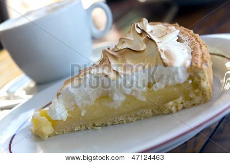 Slice of Lemon Meringue Tart on a plate