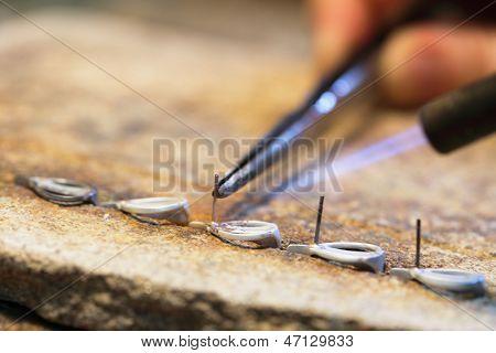 Hands Of Jeweller At Work Silver Soldering