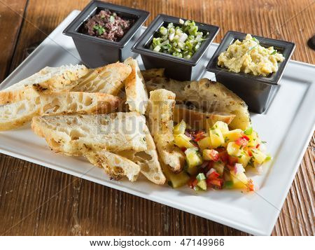 Toasted bread with salsa and dips