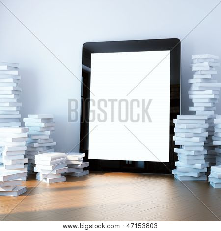 pile of books around the touchscreen device ipad-style