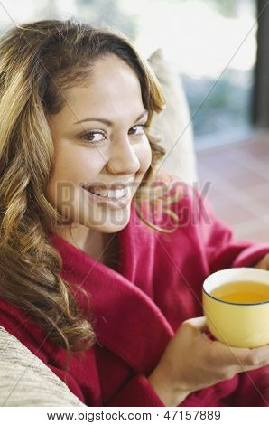 Young woman holding cup of tea