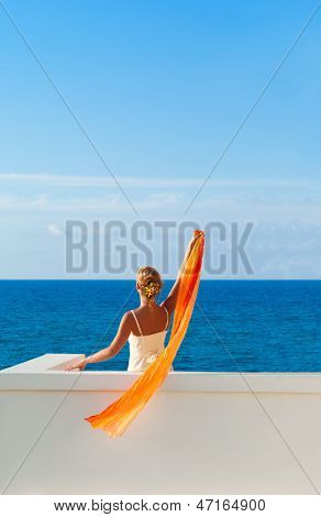 Beautiful Woman In White Dress Greeting Somebody From The Sea