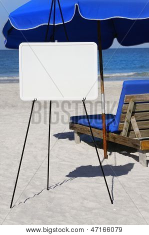 Blank Sign And Blue Umbrella