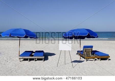 Sign And Blue Umbrellas