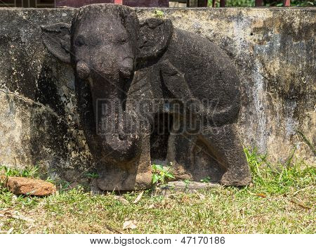 Damaged Elephant Statue On Bas Relief Of Chien Dam Cham Tower.