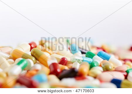 Colorful medication medicine background with pills and capsules