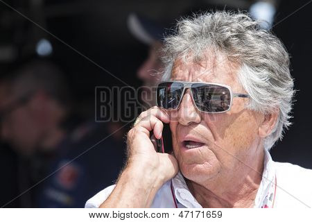 Fort Worth, TX - Jun 07, 2013:  Mario Andretti watches the IZOD IndyCar Series teams take to the track for the Firestone 550 race at the Texas Motor Speedway in Fort Worth, TX on June 07, 2013.
