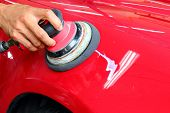 Hand with a Machine polishing the car poster