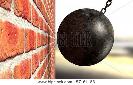 A regular metal wrecking ball attached to a chain hitting and breaking a face brick poster